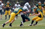 Eldred's Shaun Berger and Charles Wolff team up to tackle Spackenkill's Brian Usavich.