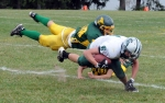 Eldred's Geno Jones makes a flying tackle on Spackenkill's Mark Lewis, assisted by another defensive lineman.