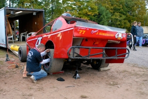 A few last minute suspension adjustments on a modified.