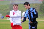 Liberty's Conor Siegel and Sullivan West's Sam Smith react to the ball blasting between them.