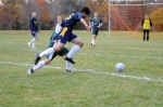 Family School's Casey Wong drives to the goal.