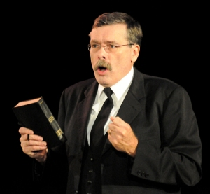 Harold Tighe in the role of Reverend Brown, a Bible-thumpin' preacherman.