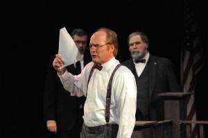 Bill Moloney as Matthew Harrison Brady, an impassioned prosecutor.