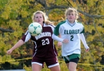 Manor's Emily Casey and Eldred's Alexis Pierce in pursuit of the ball.