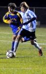 Sullivan West's Richard Lander, a freshman, holds off a Chapel Field defender.