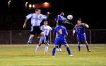 Sullivan West's Tyler Groh heads the ball toward the goal.