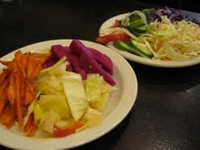 Small plates of hamutzim pickled vegetables