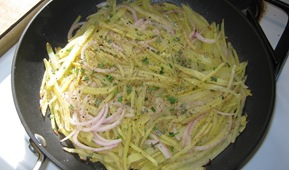 The potatoes and onions go into the skillet_reduced image
