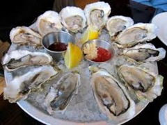 OysterswithtwosaucesatAquagrill