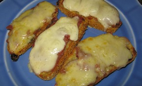 Open-faced sandwiches of fennel raisin bread with two kinds of cheese