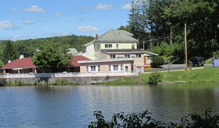 View of the Golden Swan Motel from across the lake August 2014_reduced image