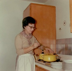 Mom at the stove with an apron around her waist